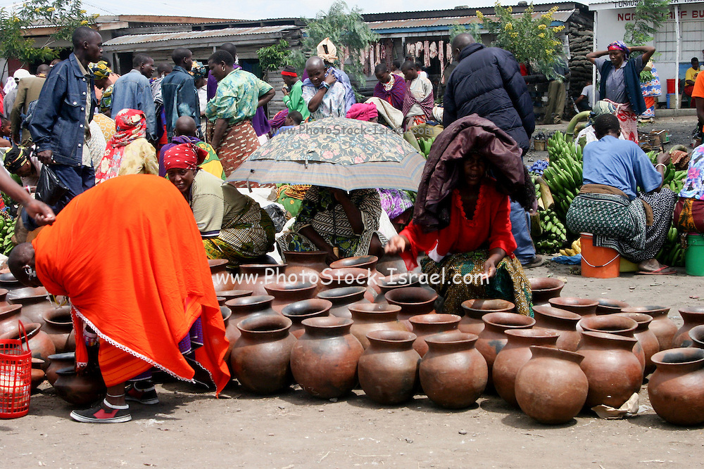 Africa, Tanzania, Frontier Market selling clay pots The goods are placed on a blanket on the ground