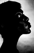 Black silhouette profile with one eye- One Woman Show