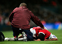 Photo: Tom Dulat/Sportsbeat Images.<br /> <br /> Arsenal v Wigan Athletic. The FA Barclays Premiership. 24/11/2007.<br /> <br /> Arsenal's Theo Walcott injured his foot after clash with Wigan's Emile Heskey.