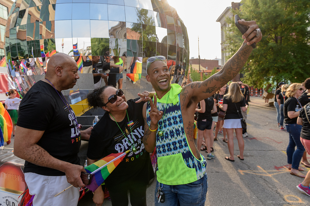 Ralph, Tammy and Conrad Deckabert take a selfie before the parade on Market Street.<br /> The Lesbian, Gay, Bisexual, Transgender, and Queer (LGBTQ) community and their friends, family and supporters walked and lined Main Street from Floyd Street to the Belvedere for the Kentuckiana Pride Parade, Saturday, June 16, 2017 in Louisville, Ky. (Photo by Brian Bohannon)