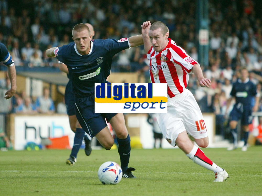 Photo: Chris Ratcliffe.<br />Southend United v Sunderland. Coca Cola Championship. 19/08/2006.<br />Danny Collins (R) of Sunderland clashes with Peter Clarke of Southend.