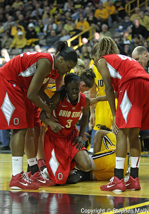 January 08 2010: Ohio St. guard Amber Stokes (3) is helped up by teammates after a fall during the first half of an NCAA womens college basketball game at Carver-Hawkeye Arena in Iowa City, Iowa on January 08, 2010. Iowa defeated Ohio State 89-76.