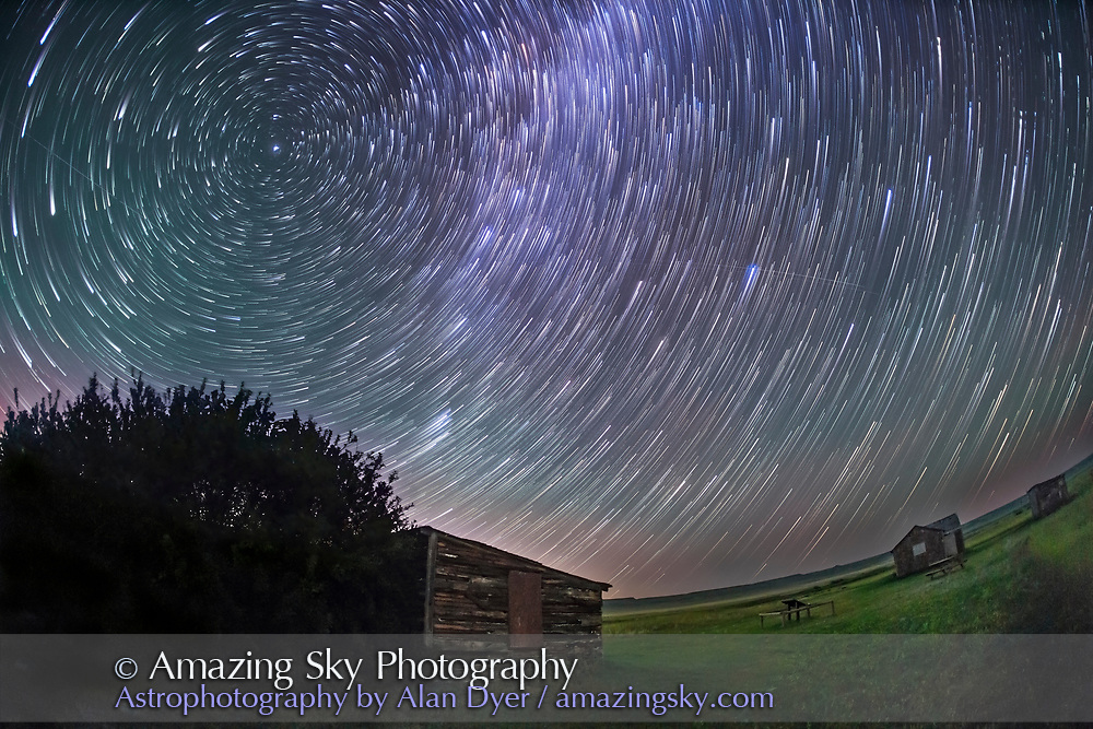 Circumpolar star trails over the old pioneer Larson Ranch in the Frenchman River Valley, in Grasslands National Park. Saskatchewan. Polaris is at upper left. This is facing east to the rising sky.<br /> <br /> This is a stack of 90 images for the sky, to create the star trails, and a stack of 5 exposures taken at the beginning of the sequence for the ground, to smooth noise. Each exposure was 45 seconds at f/2.8 with the 15mm full-ftame fish-eye lens and Canon 5D MkII at ISO 5000.