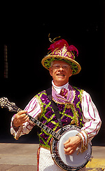 One of the famous Philadelphia Mummers entertains in a downtown plaza.  Musician is Charles Faunce.  Model release on file.