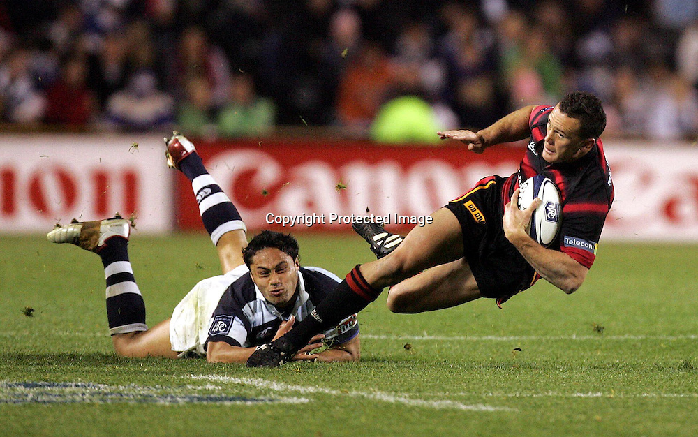 Canterbury's Caleb ralph goes down after being ankle-tapped by Auckland's Ben Atiga during the Canturbury v Auckland NPC match at Eden Park, Saturday 2 October 2004 Canterbury won 28 - 20<br />