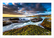 Sydney's eastern suburbs basking in the spring sunshine. View from Mackenzies Bay, Tamarama towards Bronte, NSW, Australia.<br />