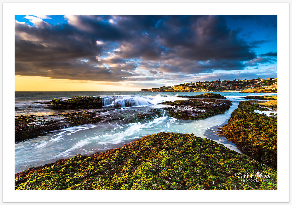 Sydney's eastern suburbs basking in the spring sunshine. View from Tamarama towards Bronte, NSW, Australia.<br /> <br /> To purchase please email orders@girtbyseaphotography.com quoting the image number PB202365, and your preferred print size. You will receive a quick reply recommending print media options to best suit your chosen image, plus an obligation-free quotation. Current standard size prices are published on the Pricing page.