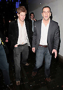 11.FEBRUARY.2011 LONDON<br /> <br /> PRINCE HARRY LEAVING THE BOX CLUB IN SOHO AT 3.30AM LOOKING A LITTLE WORSE FOR WEAR AND VERY SCRUFFY WITH THE BOTTOM OF HIS SHIRT UNDONE AS HIS SECURITY GUARDS ESCORT HIM PAST ALL THE SEX SHOPS ON THE WAY TO HIS CAR. IT WAS THE BLONDE GIRL IN THE WHITE JACKET'S BIRTHDAY AND THE OTHER GIRLS CAME OUT SAYING THAT THEY HAD BEEN PARTYING ON THE TABLE WITH HARRY. AND YOU CAN CLEARLY SEE ONE OF HARRY'S SECURITY GUARDS TAZER GUN TUCKED INTO HIS JEANS.<br /> <br /> BYLINE: EDBIMAGEARCHIVE.COM<br /> <br /> *THIS IMAGE IS STRICTLY FOR UK NEWSPAPERS AND MAGAZINES ONLY*<br /> *FOR WORLD WIDE SALES AND WEB USE PLEASE CONTACT EDBIMAGEARCHIVE - 0208 954 5968*