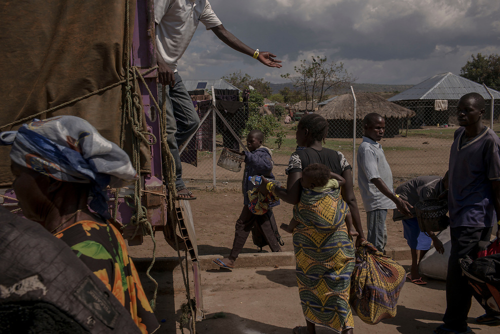 SEBAGORO, UGANDA - MARCH 22: Congolese refugees load their belongings onto a truck bound for Kyangwali refugee settlement camp after landing in Sebagoro, Uganda on March 22, 2018. Violence in Ituri Province in northeastern Democratic Republic of Congo has displaced more than 100,000 people including approximately 40,000 refugees who have fled to Uganda. (Photo by Andrew Renneisen for The Washington Post)