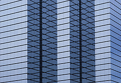 modern hi-rise corporate office building close-up, wide orientation