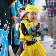 Young dancer gets restless before a street performance in Susukino