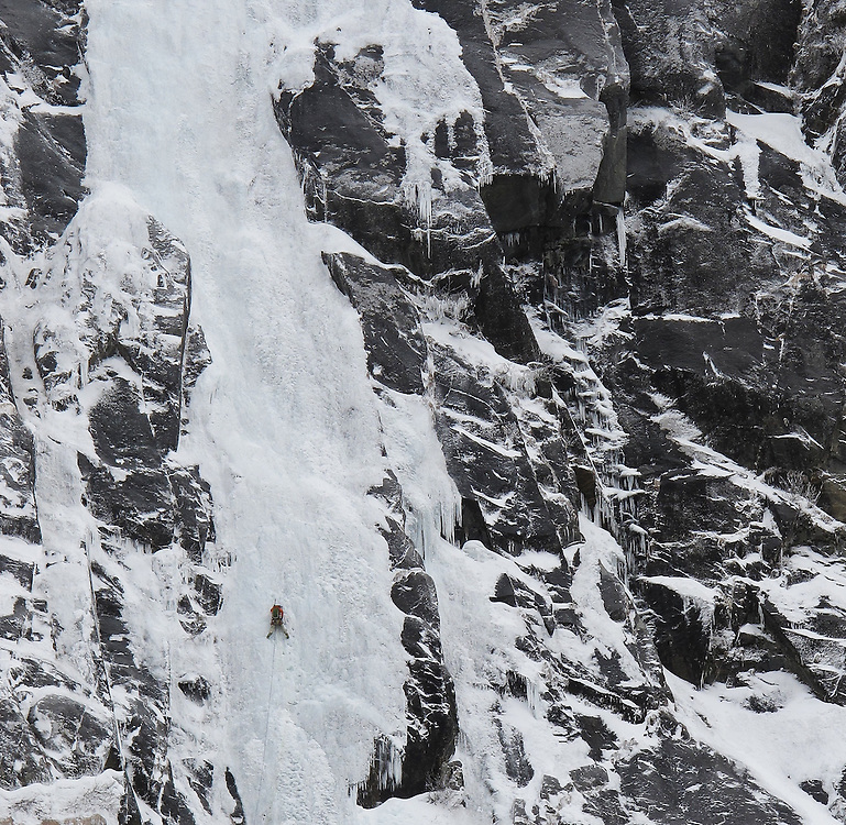 Tom Lanagan leading in style on the first ascent of Tide Line WI6 350m, Juneau, Alaska, USA
