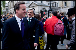 British Prime Minister David Cameron with Chris Huhne, the Secretary of State for Energy and Climate Change walking down Whitehall on their way to visit  DECC on May 14, 2010.  Photo By Andrew Parsons/i-Images