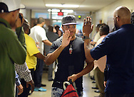 Ja'Neer Hall is greeted by a group of fathers from the community as he entered the building on the first day of classes Tuesday September 6, 2016 at Willingboro High School in Willingboro, New Jersey. (Photo by William Thomas Cain)
