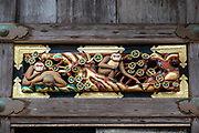 """One monkey faces the world head on, while another, looking down with trepidation is encouraged by a friend."" Hidari Jingoro may have carved these panels to incorporate Confucius's Code of Conduct, using the monkey as a way to depict man's life cycle. Art work on storehouse in Toshogu shrine in Nikko, Japan. The monkeys are Japanese macaques, a common species in Japan. Toshogu Shrine is the final resting place of Tokugawa Ieyasu, the founder of the Tokugawa Shogunate that ruled Japan for over 250 years until 1868. Ieyasu is enshrined at Toshogu as the deity Tosho Daigongen, ""Great Deity of the East Shining Light"". Initially a relatively simple mausoleum, Toshogu was enlarged into the spectacular complex seen today by Ieyasu's grandson Iemitsu during the first half of the 1600s. The lavishly decorated shrine complex consists of more than a dozen buildings set in a beautiful forest. Toshogu contains both Shinto and Buddhist elements, as was common until the Meiji Period when Shinto was deliberately separated from Buddhism. Toshogu is part of Shrines and Temples of Nikko UNESCO World Heritage site."