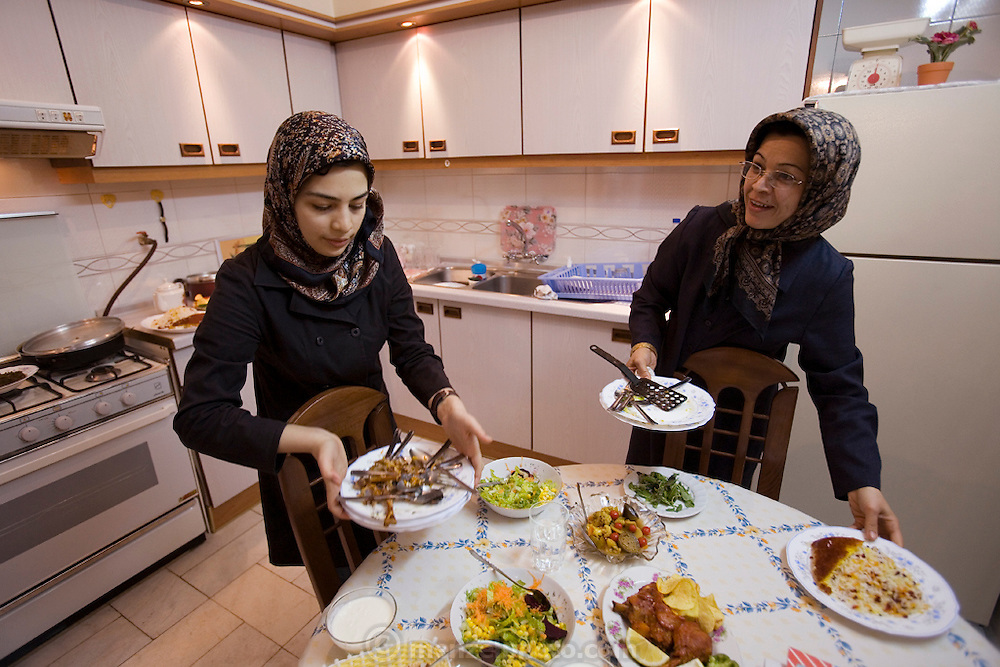 Atefeh Fotowat, a high school student and aspiring fashion designer, with her mother in the kitchen of their home in Isfahan, Iran. (Atefeh Fotowat is featured in the book What I Eat: Around the World in 80 Diets.)