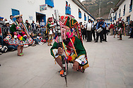 Mamacha del Carmen of Paucartambo. A member of Kachampa dance group genuflected in front of the main church, where Mamacha is hosted