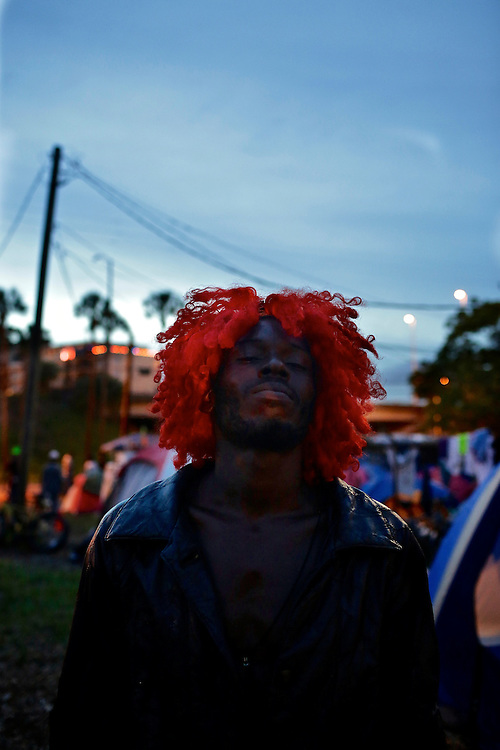 Curtis Hunt Jr. of St. Petersburg, dances to music in Romneyville, where many of the protestors camped out, during the 2012 Republican National Convention in Tampa, Fla. on Aug. 29, 2012.