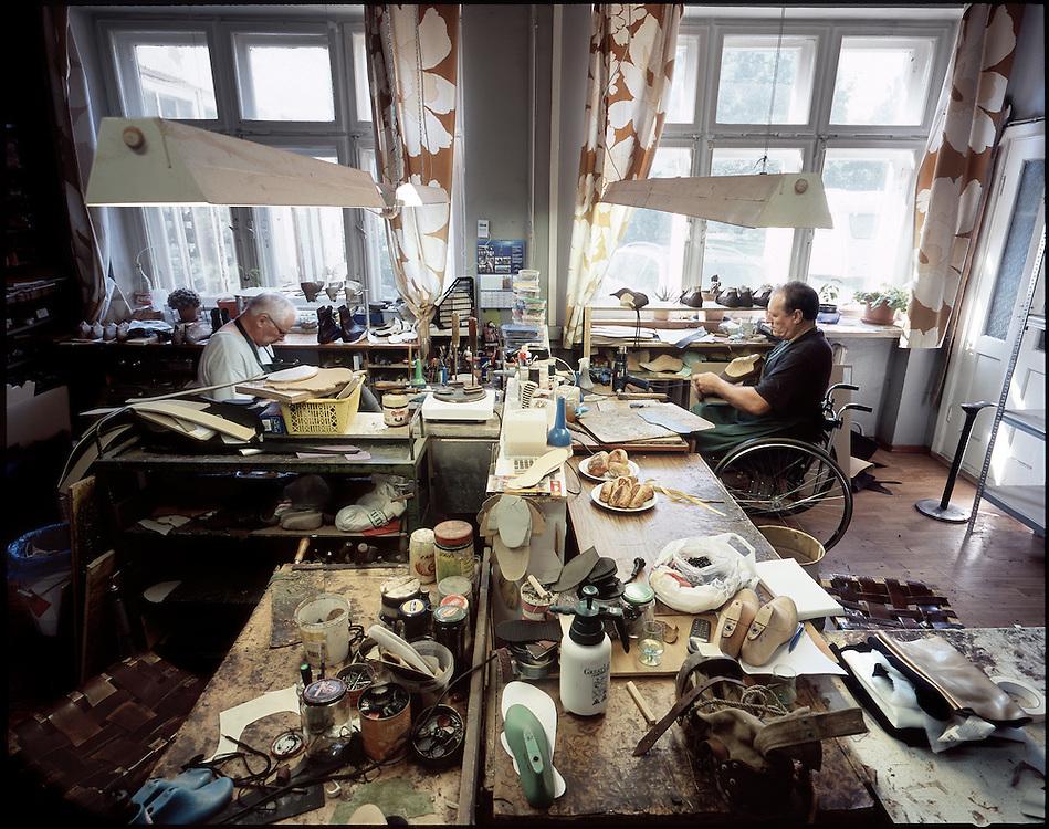 Shoemakers at work in the studio of RV Ortopeedia.
