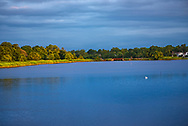 The still blue waters of  Wreck Pond in Sea Girt shortly after daybreak.