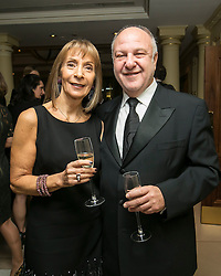 © Licensed to London News Pictures. 09/12/2014.LONDON UK. Diana and Harvey Goldsmith.<br /> <br /> Media Society Annual Dinner 2014. Alan Yentob, Creative Director of the BBC, received the Media Society award honouring his diverse career in broadcasting at the Society's annual dinner, held at the Millennium Hotel Mayfair, London. Photo credit : ANDREW BAKER/LNP