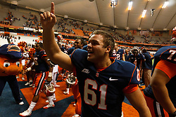 Oct 21, 2011; Syracuse NY, USA;  Syracuse Orange long snapper Eric Morris (61) celebrates after the game against the West Virginia Mountaineers at the Carrier Dome.  Syracuse defeated West Virginia 49-23. Mandatory Credit: Jason O. Watson-US PRESSWIRE