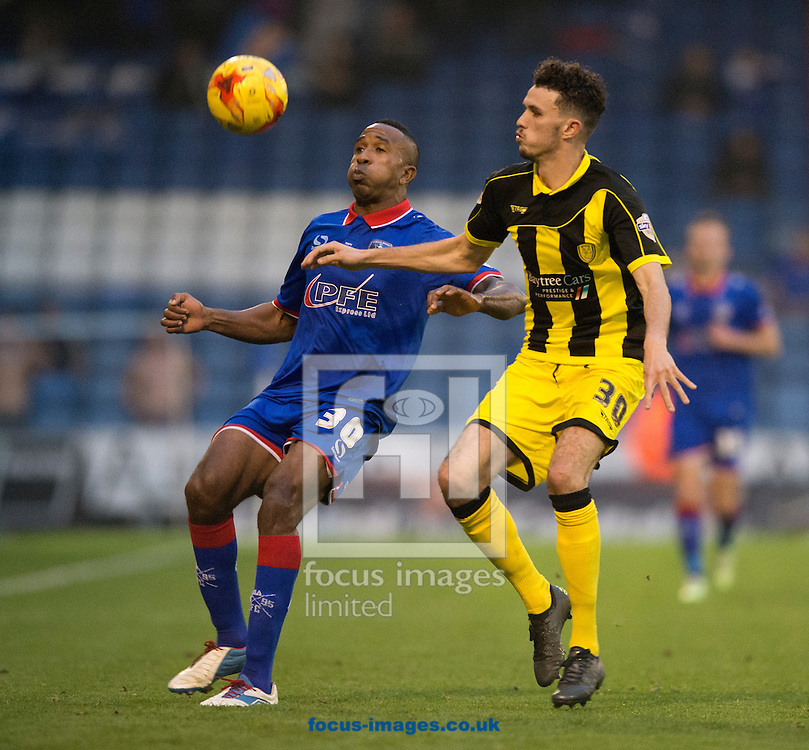 Ricardo Fuller of Oldham Athletic (left) competes for the ball with Tom Flanagan of Burton Albion during the Sky Bet League 1 match at Boundary Park, Oldham<br /> Picture by Russell Hart/Focus Images Ltd 07791 688 420<br /> 31/10/2015