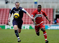 Photo: Leigh Quinnell.<br /> Middlesbrough v Manchester City. The Barclays Premiership. 31/12/2005. Middlesbroughs Yakubu battles with Man Citys Richard Dunne.