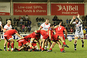 Sebastian Bezy kicks over Bryn Evans during the European Rugby Challenge Cup match between Sale Sharks and Toulouse at the AJ Bell Stadium, Eccles, United Kingdom on 13 October 2017. Photo by George Franks.