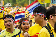 05 DECEMBER 2012 - BANGKOK, THAILAND:  Students dressed in yellow, the color of the Thai monarchy, gather on the Royal Plaza in Bangkok Wednesday to see Bhumibol Adulyadej, the King of Thailand, before his public audience at the Mukkhadej balcony of the Ananta Samakhom Throne Hall. December 5 is a national holiday. It's also celebrated as Father's Day. Celebrations are being held across the country to mark the birthday of Bhumibol Adulyadej, the King of Thailand.   PHOTO BY JACK KURTZ