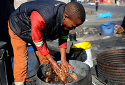 Cape Town-180829 Street vendor thoroughly scrubbed and rinsed well to remove all hairs. The Sheep head also know as Smiley is very popular in the township it used to be cooked only if threr was traditional cremony nowadays there are many places that clean and sell this delicacy,cooked or uncooked  Pictures Ayanda Ndamane/African/news/agency ANA