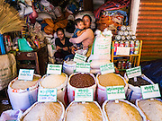 01 JUNE 2016 - SIEM REAP, CAMBODIA: Rice for sale in the Siem Reap market. There are growing concerns that spot food shortages, especially of fish, the Cambodians main source of protein, could become worse if the coming rainy season doesn't bring relief from the drought that has gripped Cambodia for the last two years.          PHOTO BY JACK KURTZ
