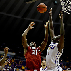 Jan 14, 2017; Baton Rouge, LA, USA; Alabama Crimson Tide forward Bola Olaniyan (21) shoots over LSU Tigers forward Duop Reath (1) during the first half of a game at the Pete Maravich Assembly Center. Mandatory Credit: Derick E. Hingle-USA TODAY Sports