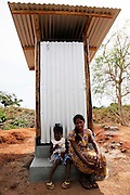 Twenty-five-year-old Thayaparan and her six-year-old daughter Mutalakshmi sit on the step of their new toilet in the village of Kalvallam, northern Sri Lanka. The toilet has been built by the UN's Office for Project Services (UNOPS), with funding from UKaid.<br /> <br /> To find out more about how DFID is helping in Sri Lanka, please visit www.dfid.gov.uk/srilanka ( http://www.dfid.gov.uk/srilanka ) <br /> <br /> Image: Russell Watkins / Department for International Development<br /> <br /> This photo is posted under a Creative Commons - Attribution license, in line with the Open Government License ( http://www.nationalarchives.gov.uk/doc/open-government-licence/ ) . You are free to download and use it as long as you credit the source.