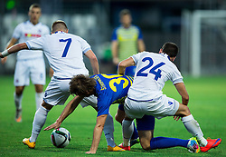 Jaka Stromajer #30 of Luka Koper between Artem Radchenko of Hajduk and  Marko Pejic of Hajduk during First Leg football match between FC Luka Koper and HNK Hajduk Split (CRO) in Second qualifying round of UEFA Europa League, on July 16, 2015 in Stadium Bonifika, Koper, Slovenia. Photo by Vid Ponikvar / Sportida
