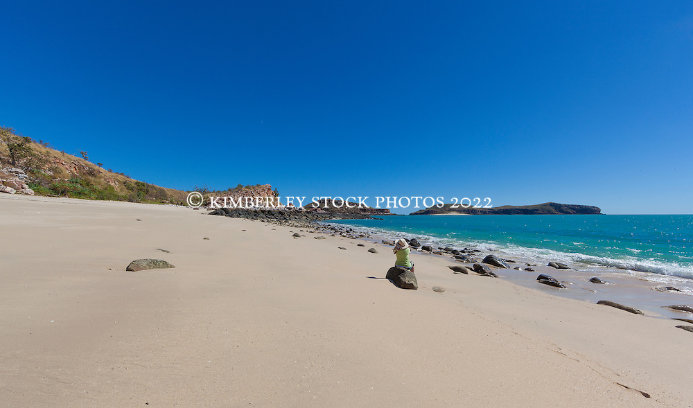 A passenger on a research vessel on a beach near the Vulcan Islands in Camden Sound on the Kimberley coast.