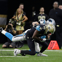 Jan 7, 2018; New Orleans, LA, USA; New Orleans Saints wide receiver Brandon Coleman (16) is tackled by Carolina Panthers middle linebacker Luke Kuechly (59) during the first quarter in the NFC Wild Card playoff football game at Mercedes-Benz Superdome. Mandatory Credit: Derick E. Hingle-USA TODAY Sports