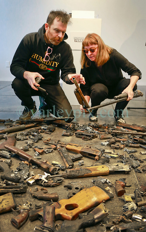 16 April 2014. Jonathan Ferrara Gallery, New Orleans, Louisiana. <br /> L/R; Artists Skyler Fein and Debora Luster at the Jonathan Ferrara Gallery to announce the 'Guns In The Hands Of Artists' project where artists take parts from 190 destroyed weapons acquired by the New Orleans Police department through a buy-back program and convert them into art.  <br /> Photo; Charlie Varley/varleypix.com