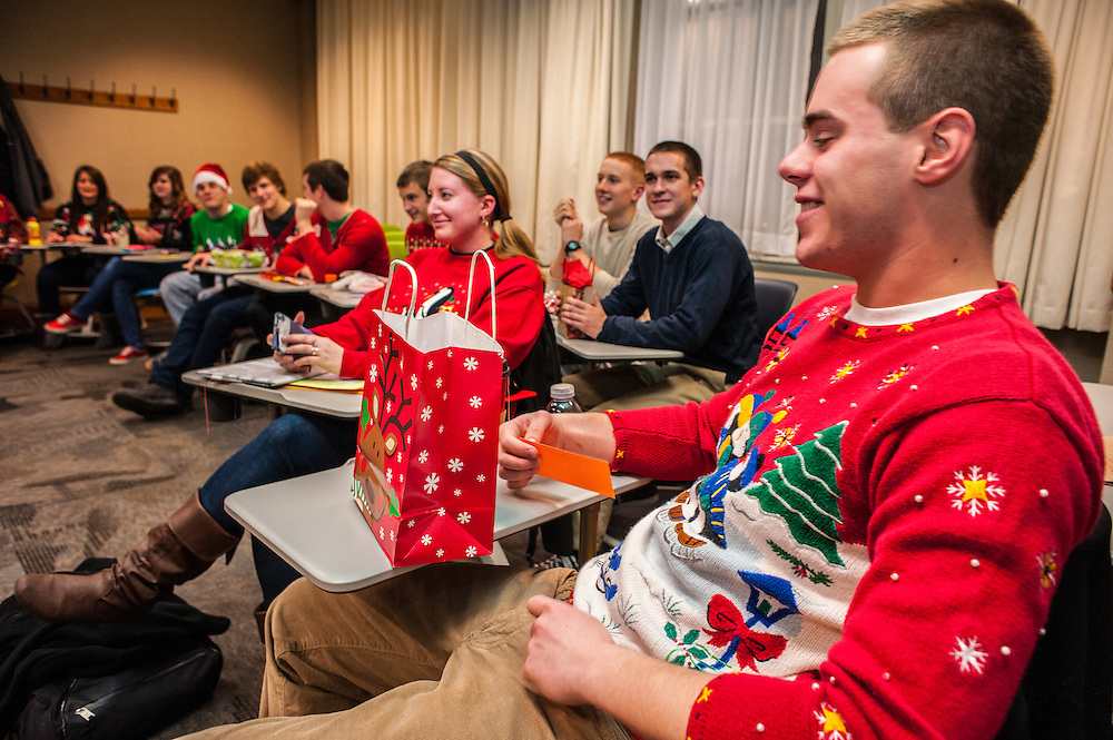 Jared Dudas, freshmen, is the first to open his secret santa gift during The College of Business Honors Program's Christmas party in Copeland Hall on Wednesday, December 5, 2012.