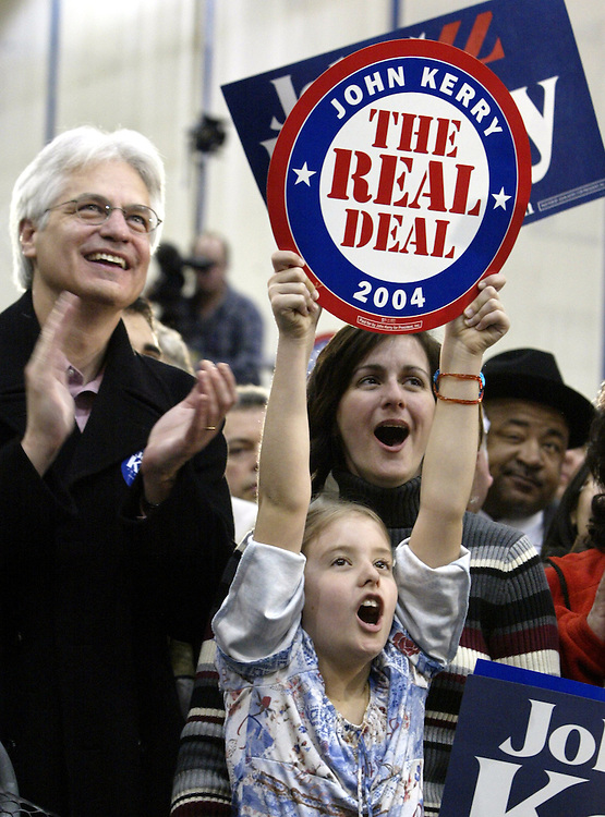 Jim Newsom (R), Chloe Cinibulk (Center) and her mother Jerri Newsom (L) cheer at a rally for United States Senator and Democratic Presidential hopeful John Kerry at Oscar E Smith High School in Chesapeake, Virgina Sunday 08 February 2004. EPA PHOTO/ANDREW GOMBERT