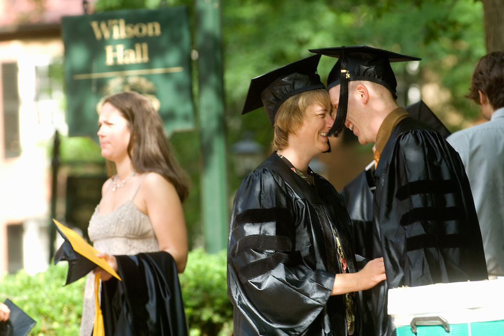 Sheila Whiteley, D. O., and Nathan Lowien, D. O., share a special moment before commencement ceremonies on June 7 for the Ohio University College of Osteopathic Medicine.