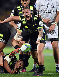Hurricanes TJ Perenara clears the ball from a ruck against the Sharks in the Super Rugby match at McLean Park, Napier, New Zealand, Friday, April 06, 2018. Credit:SNPA / Ross Setford