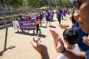 Supporters applaud as Survivors kick off the opening lap during Relay For Life at the Milpitas Sports Center in Milpitas, California, on June 22, 2013. (Stan Olszewski/SOSKIphoto)