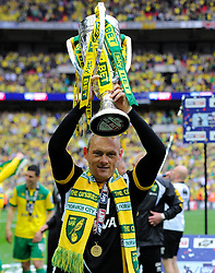 Norwich City Manager, Alex Neil lifts the sky bet football league trophy as Norwich City win promotion to the premier league   - Photo mandatory by-line: Joe Meredith/JMP - Mobile: 07966 386802 - 25/05/2015 - SPORT - Football - London - Wembley Stadium - Middlesbrough v Norwich - Sky Bet Championship - Play-Off Final