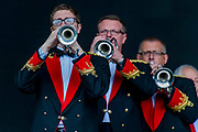 The Black Dyke Brass Band plays to a small but aprreciative audience early on Sunday morning - The 2017 Glastonbury Festival, Worthy Farm. Glastonbury, 25 June 2017
