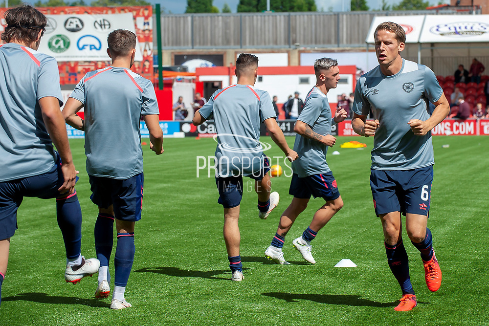 Christophe Berra of Heart of Midlothian warms up before the Ladbrokes Scottish Premiership League match between Hamilton Academical FC and Heart of Midlothian FC at New Douglas Park, Hamilton, Scotland on 4 August 2018. Picture by Malcolm Mackenzie.