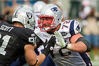 02 October 2011: Tackle (72) Matt Light of the New England Patriots blocks against the Oakland Raiders during the second half of the Patriots 31-19 victory against the Raiders in an NFL football game at O.co Stadium in Oakland, CA.