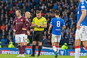 Steven Naismith of Hearts & Ryan Jack of Rangers FC go into the book during the Betfred Scottish League Cup semi-final match between Rangers and Heart of Midlothian at Hampden Park, Glasgow, United Kingdom on 3 November 2019.