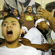 Vasco fans sing and dance to the samba beat played by drummers in the stands as the support their team during the Vasco V Atletico MG during the Brasileiro  league match as São Januário Stadium. The match ended in a 1-1 draw, Rio de Janeiro, Brazil. 9th September 2010. Photo Tim Clayton.