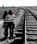"Remember Auschwitz!  Two Norwegian girls travel for peace. Here they are at the end of the railroad track in the death camp Auschwitz II - Birkenau.  In the background the gate where more than one million judes entered to face the death in the gass chambers to full-fill the nazi's ""final solution"" to the Judish problem."